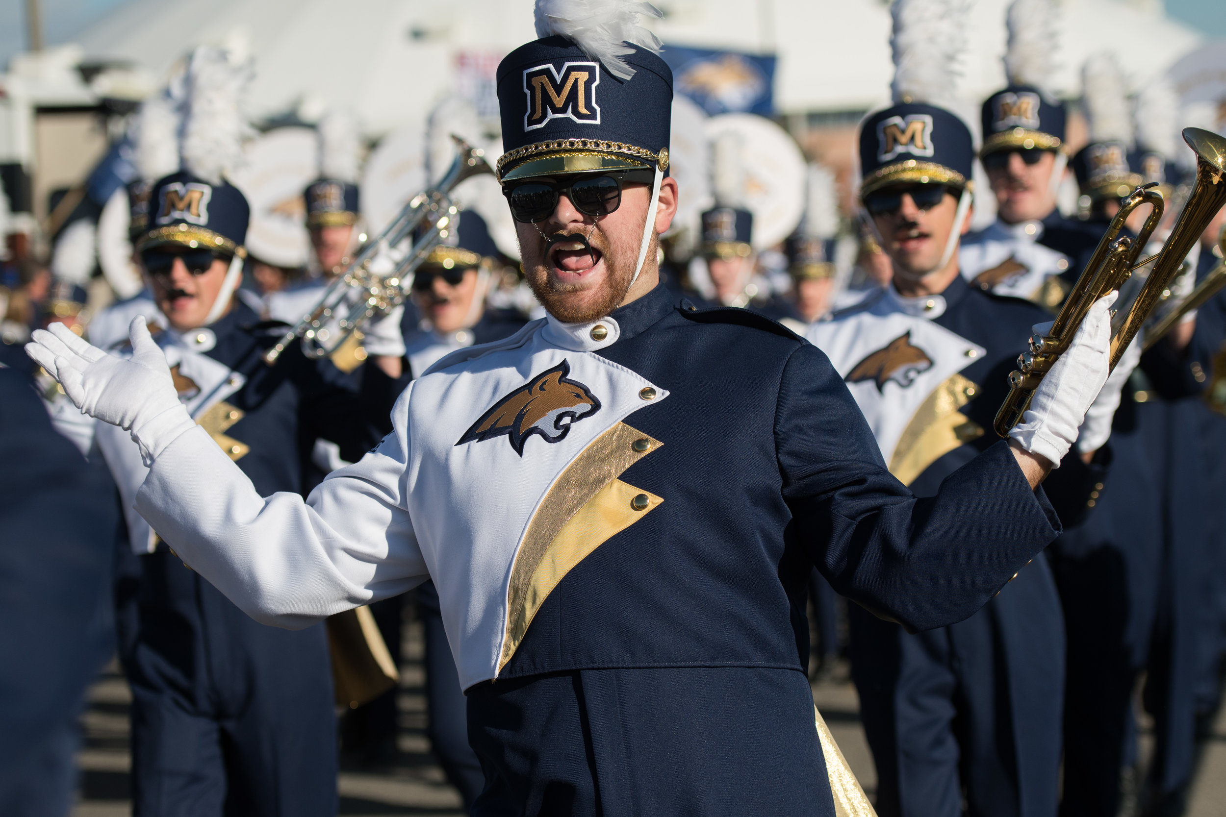 Spirit of the West trumpet player Jimmy Kelsey participates in the Bobcat Prowl prior to a football game in Bozeman, Mont. Saturday, Oct. 07, 2017.