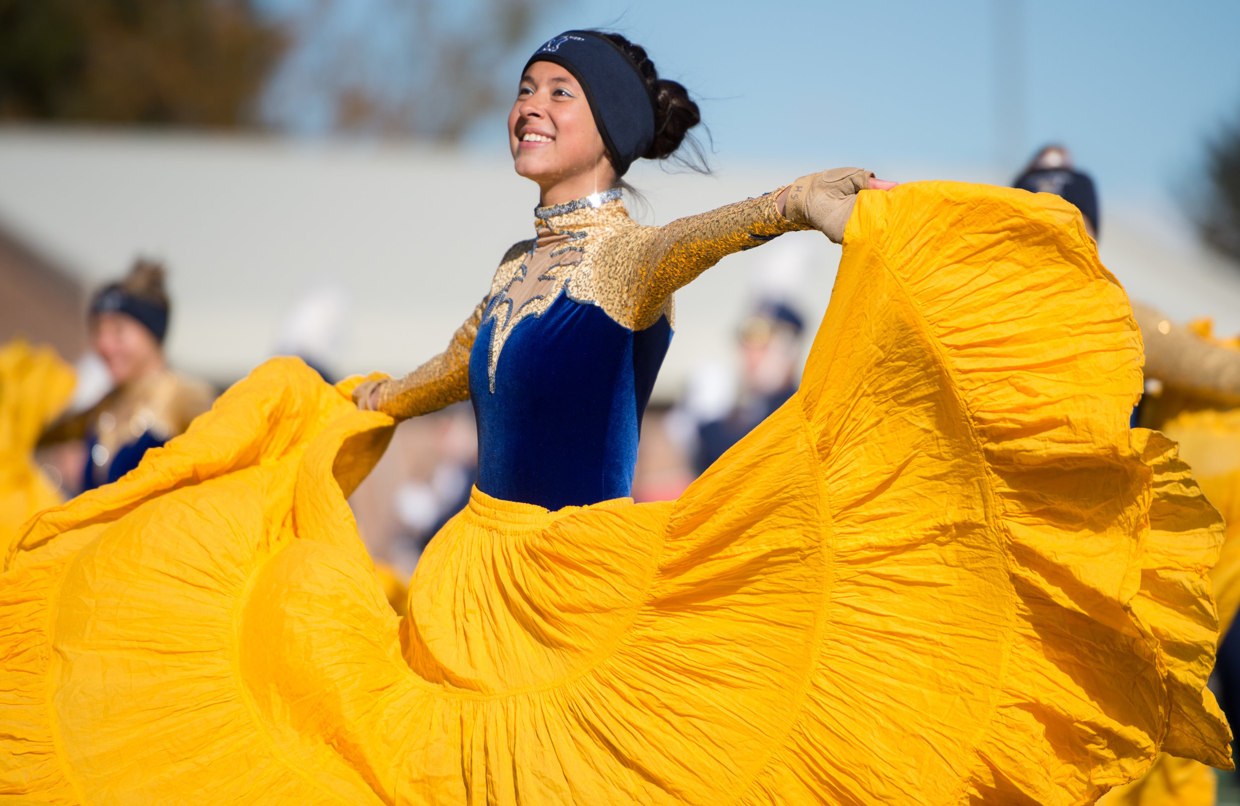 Spirit of the West color guard member Hannah Speers performs during the first annual Showcase of Bands in Bozeman, Mont. Saturday, Oct 14, 2017.