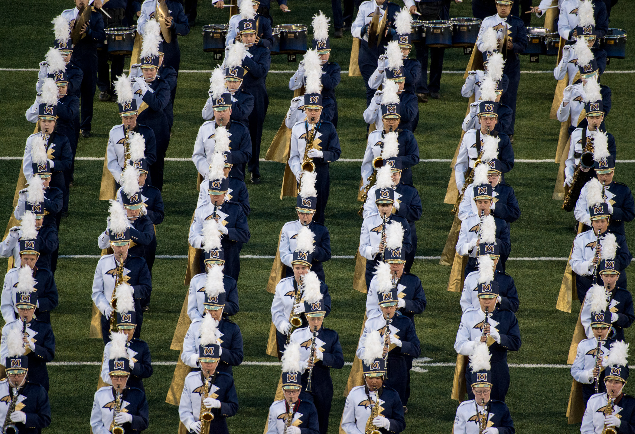 The Spirit of the West wind section walk the line during a halftime performance in Bozeman, Mont. Saturday, Sept. 09, 2017.