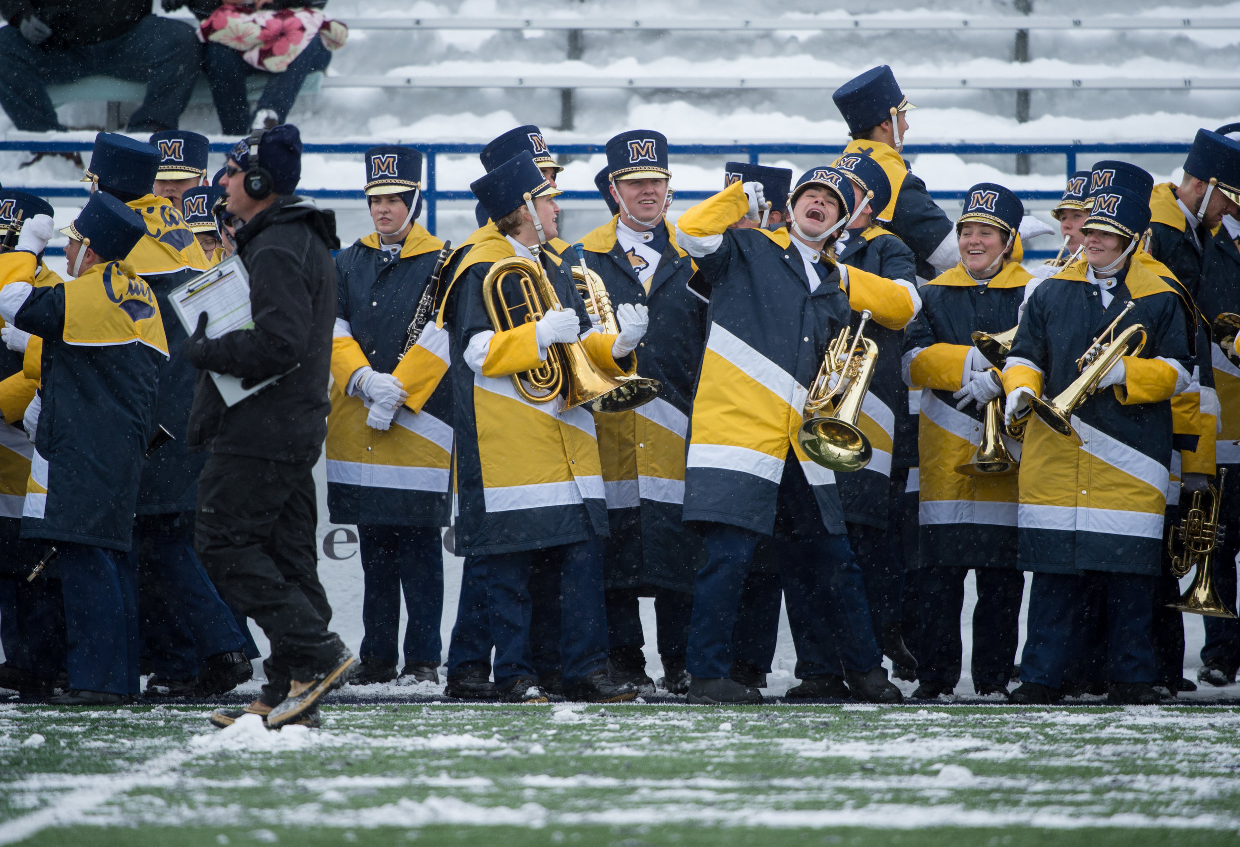 Spirit of the West members dance during pregame prior to their pregame performance during a football game in Bozeman, Mont. Saturday, Nov. 04, 2017.