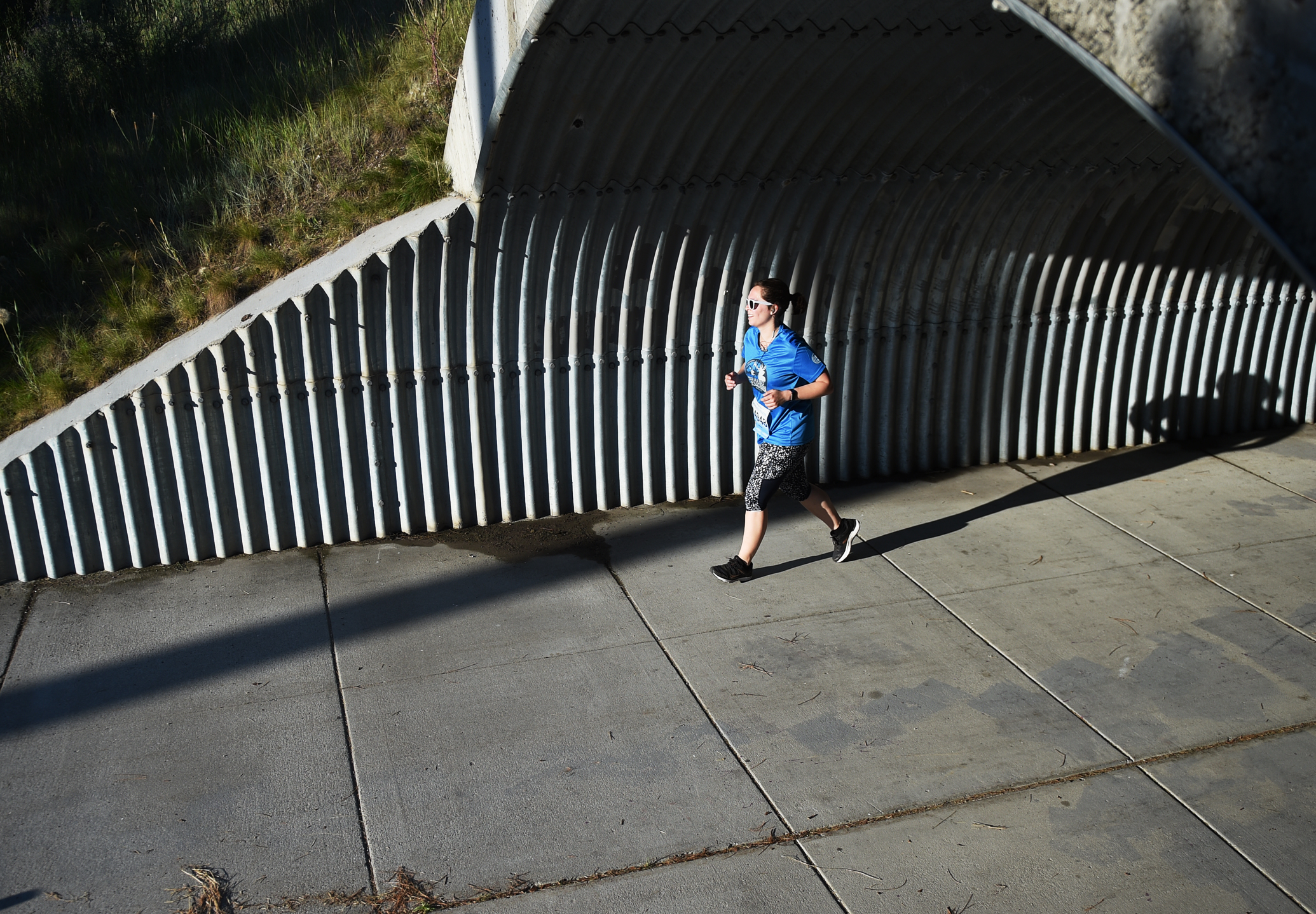 Eliza Warner, from San Francisco, Calf, exits the Reserve Street tunnel just after the halfway point for the half marathon competitors.