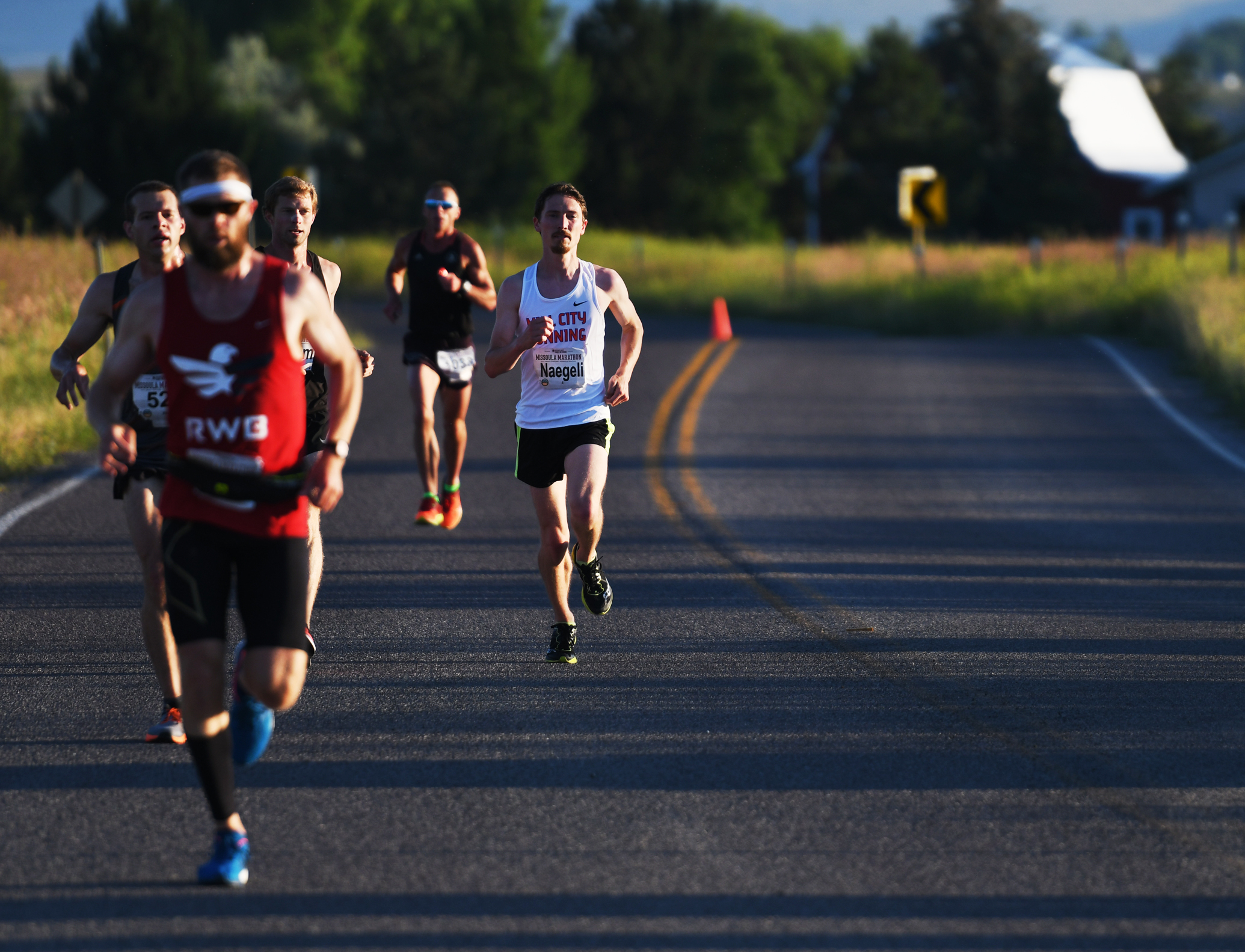 Jacob Naegli , right, from St. Paul, Minn. approaches the Deschamps aid station which marks 8.5 miles down for the marathon runners.