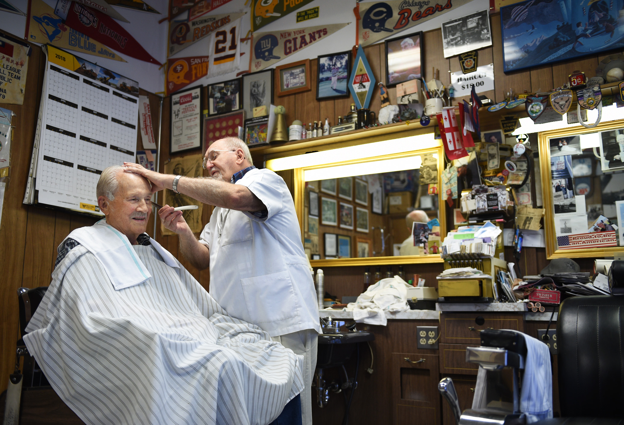 "Steve Boldizar, right, cuts Dick Ramberg's hair recently in the Capital Barber Shop on Main Street. Ramberg has been coming to Boldizar to get his hair cut for nearly 57 years. ""Use to get a hayin' season haircut,"" he recalls."