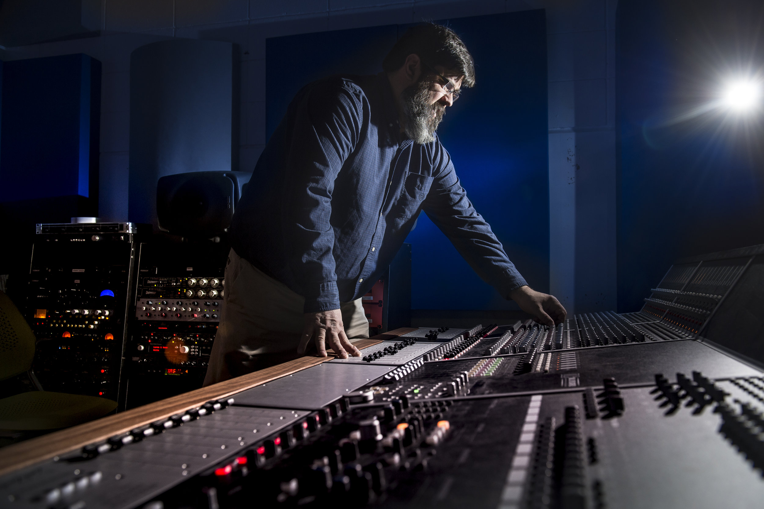 "Montana State University music technologies professor Jason Bolte poses for a portrait in the ""Monster Mixing Room"" on Montana State's Campus Monday, Mar. 19, 2018."