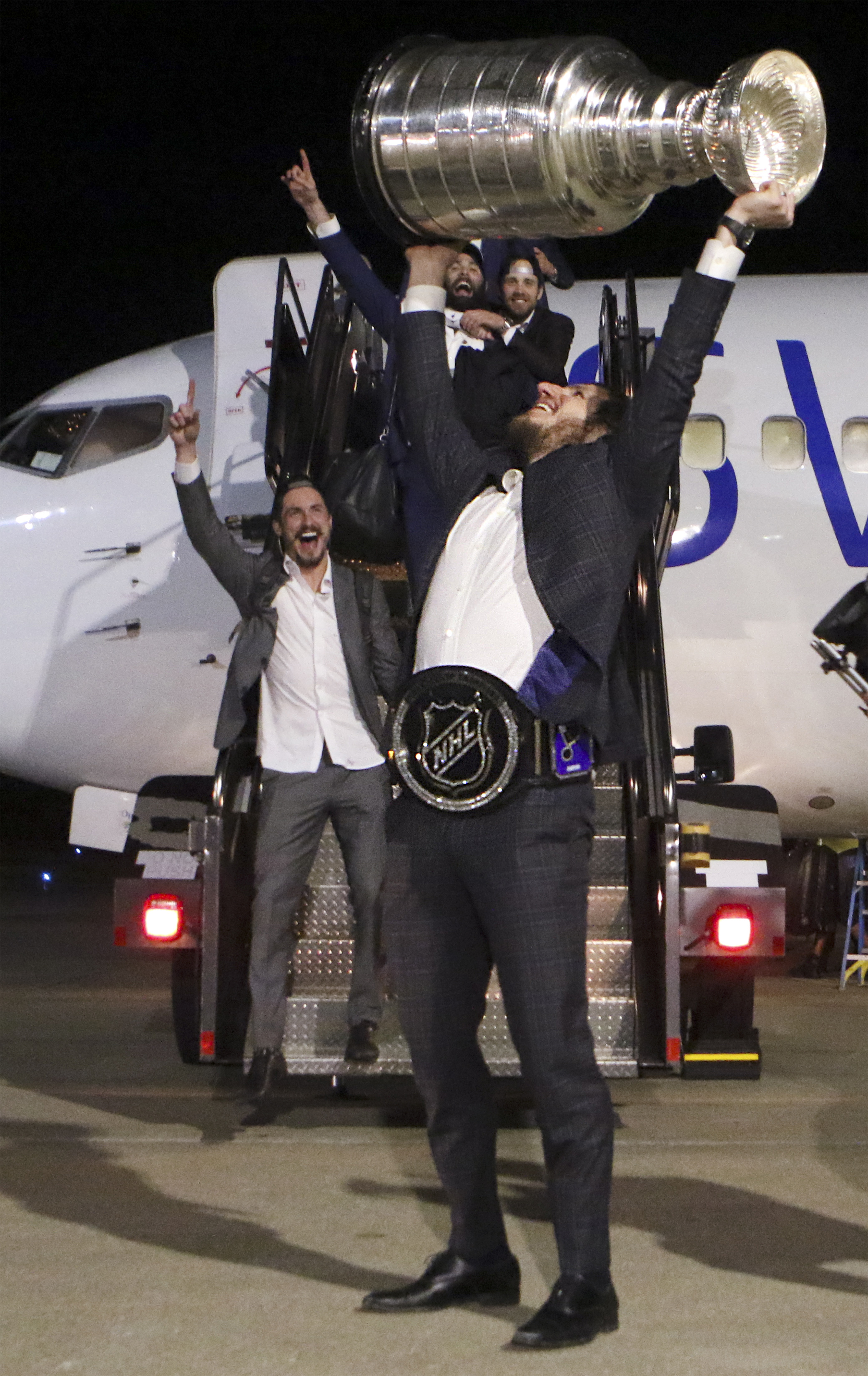 Alexander Steen hoists the Stanley Cup over his head after disembarking the plane on Thursday, June 13, 2019 as the team arrives home from Boston at Lambert International Airport.