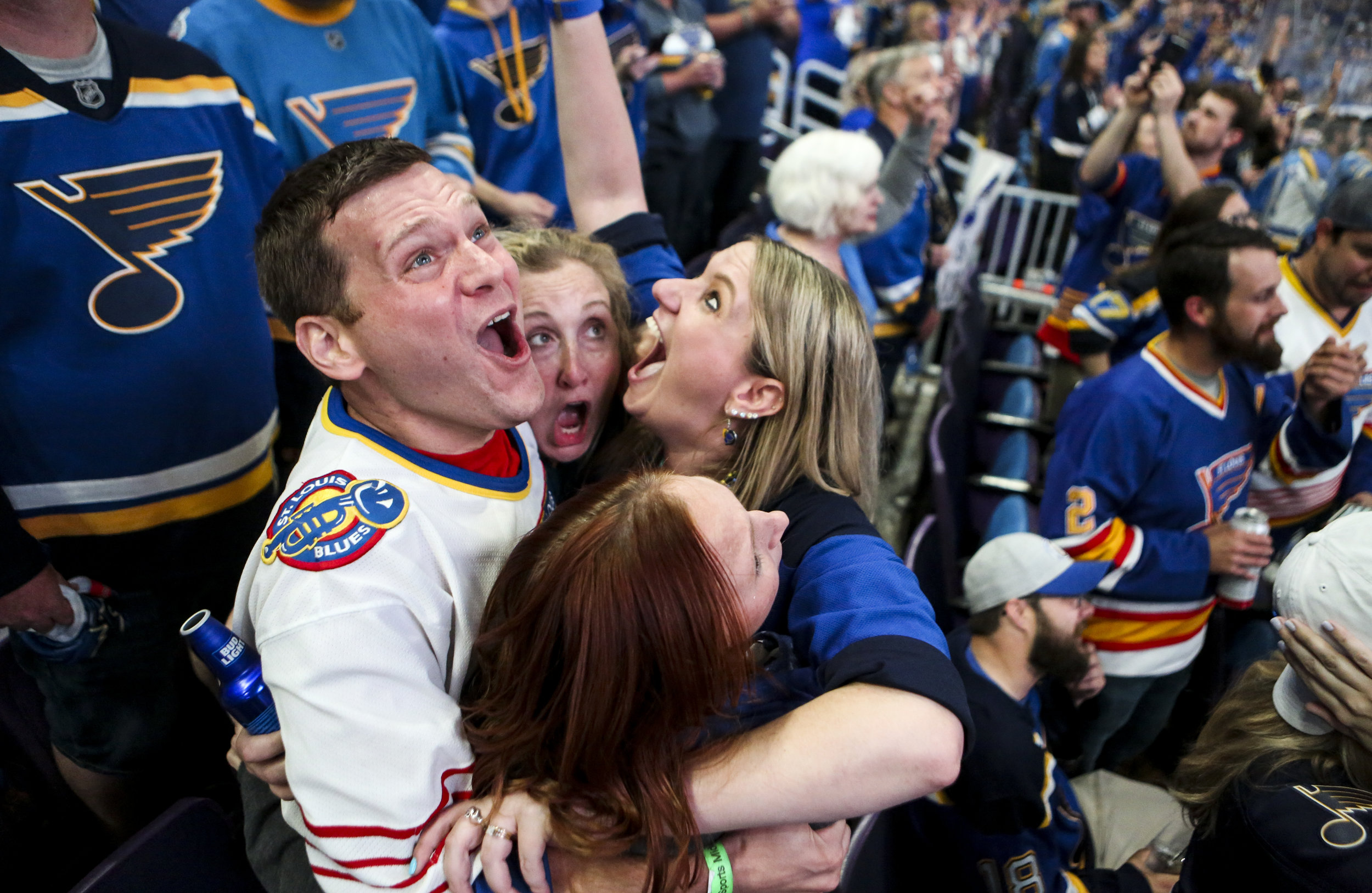 Bill Kess, left, and his friends react as the clock hits zero and the Blues win the Stanley Cup during the Stanley Cup Final Game 7 watch party on Wednesday, June 12, 2019 at the Enterprise Center.