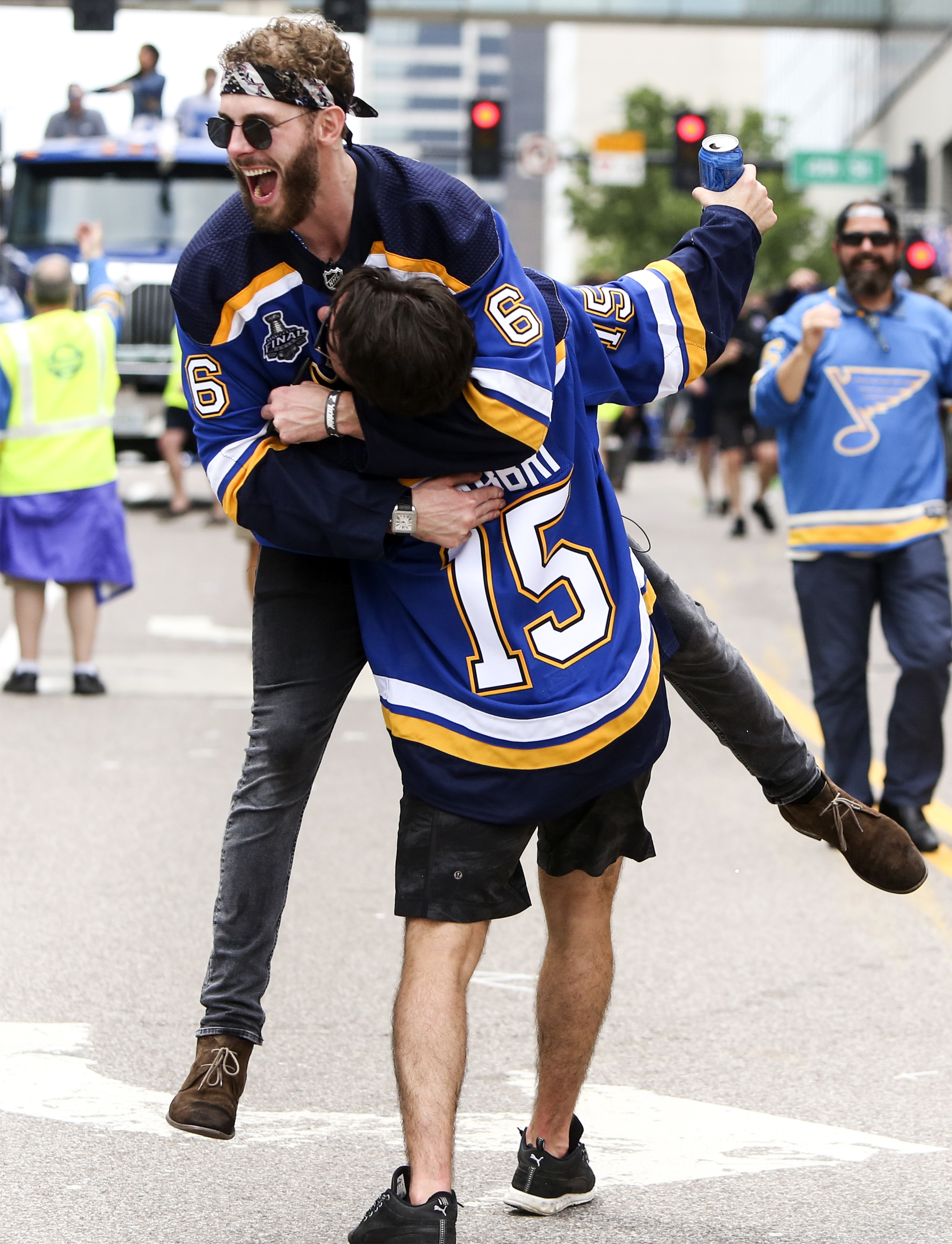 Joel Edmundson jumps on Robby Fabbri during the Blues Stanley Cup victory parade on Saturday, June 15, 2018 along Market Street in Downtown St. Louis.