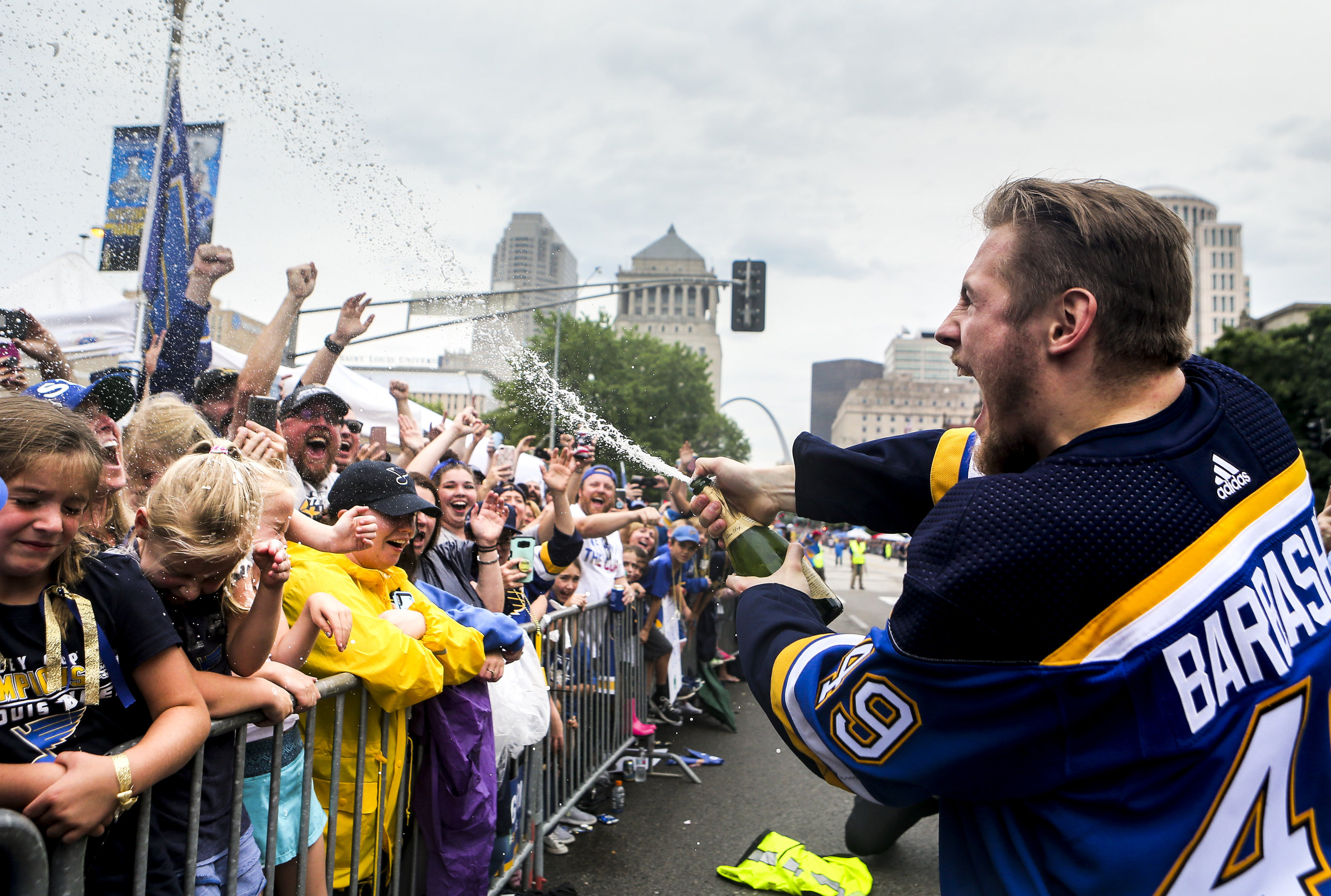Ivan Barbashev sprays a bottle of champagne into the crowd during the Blues Stanley Cup victory parade on Saturday, June 15, 2018 along Market Street in Downtown St. Louis.