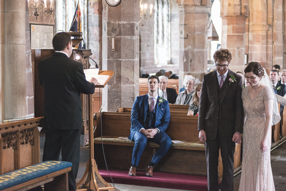 Couple laugh during service in St Michaels Church Croston, Lancashire