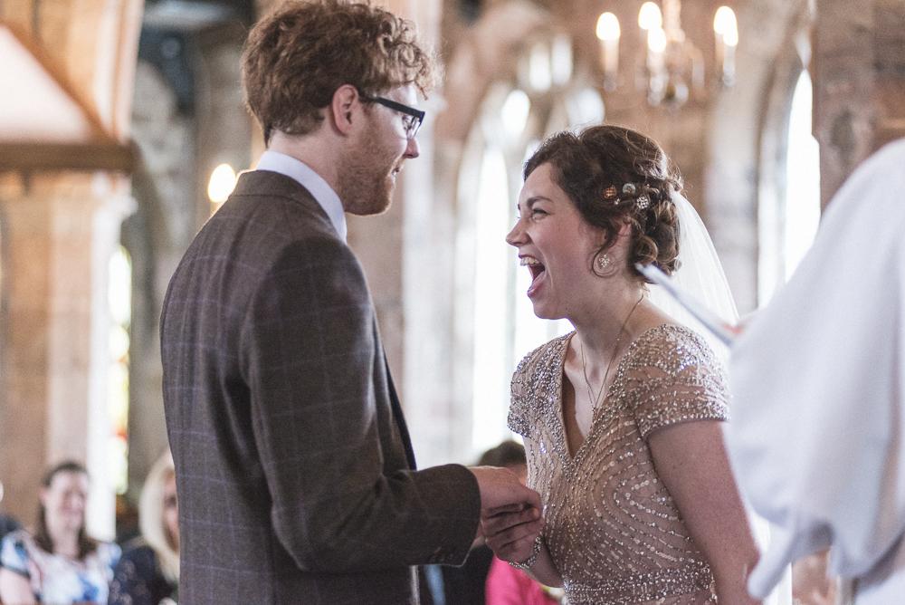 Bride laughs during service in St Michael's Church Croston Lancashire