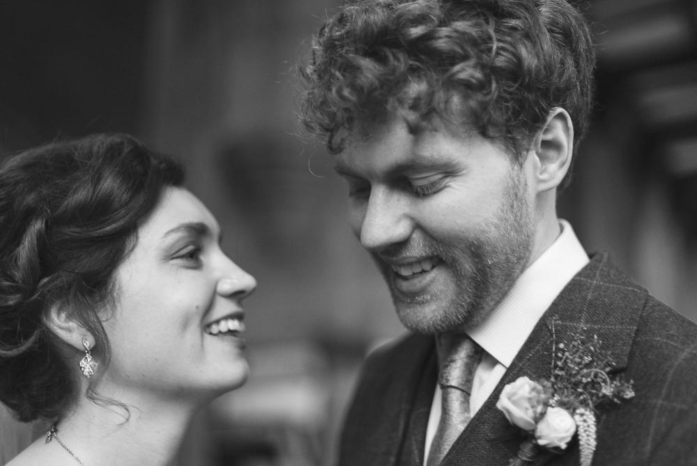 Bride gazes lovingly at groom in the church of St Michael's Croston Lanacshire