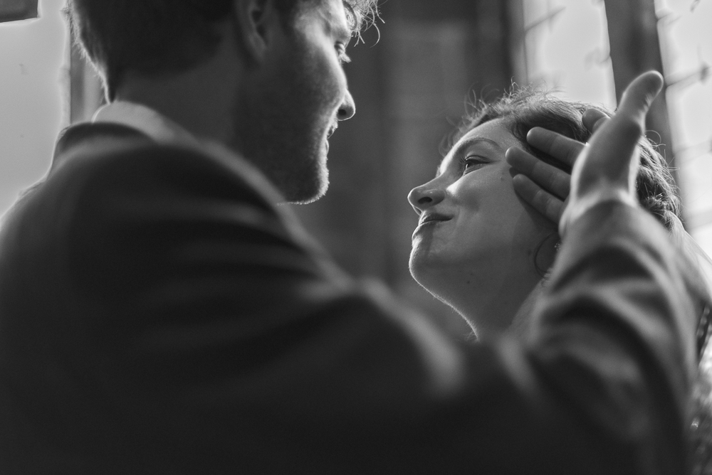 Groom plays with brides hair in a loving moment, in the church of St Michael's Croston Lancashire
