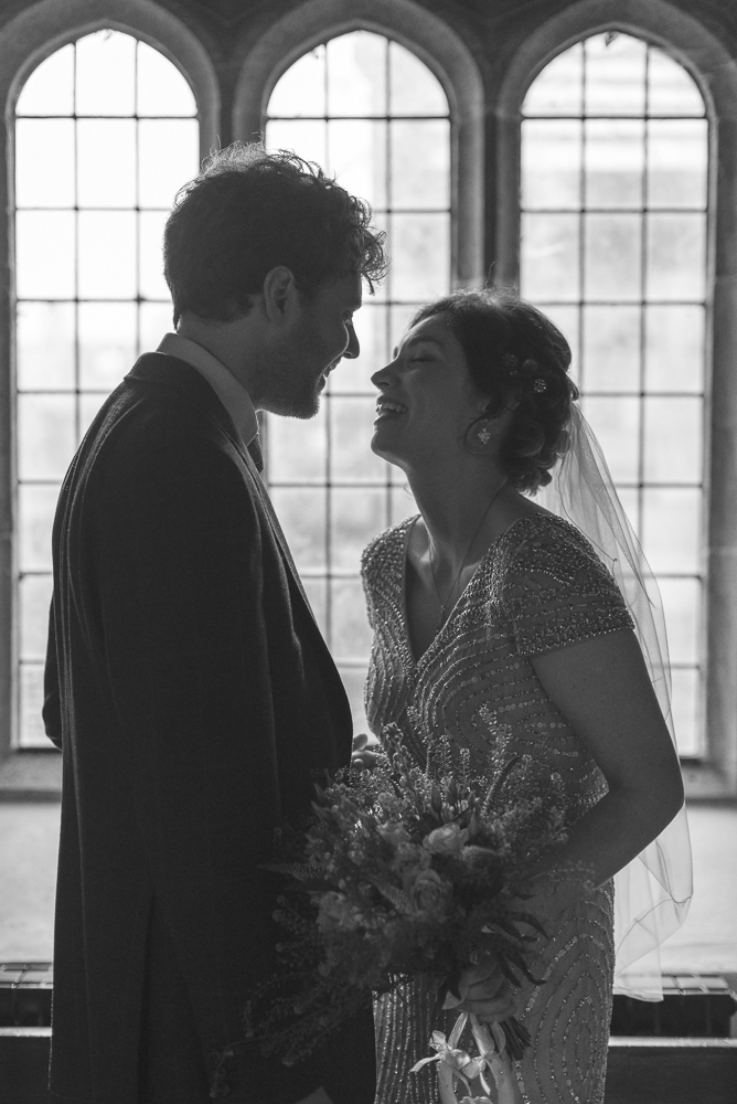 Silhouette of bride and groom in St michael's church Croston Lancashire