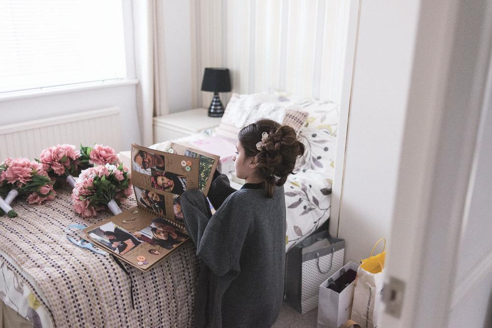 Girl looking through wedding album