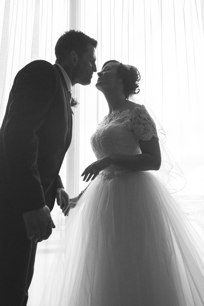 Silhouette of Bride and groom kiss in Media City, Salford