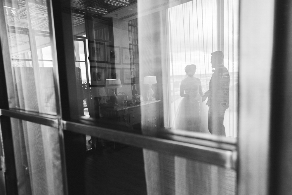 Reflection of bride and groom in Media City