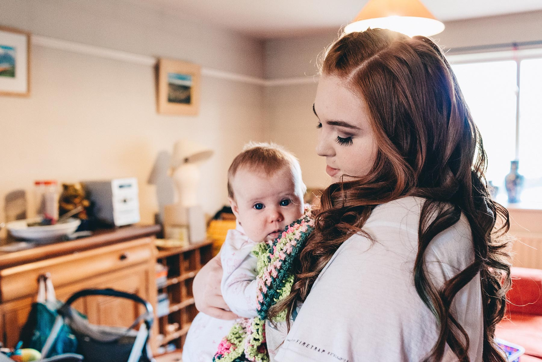 bridesmaid holding a baby