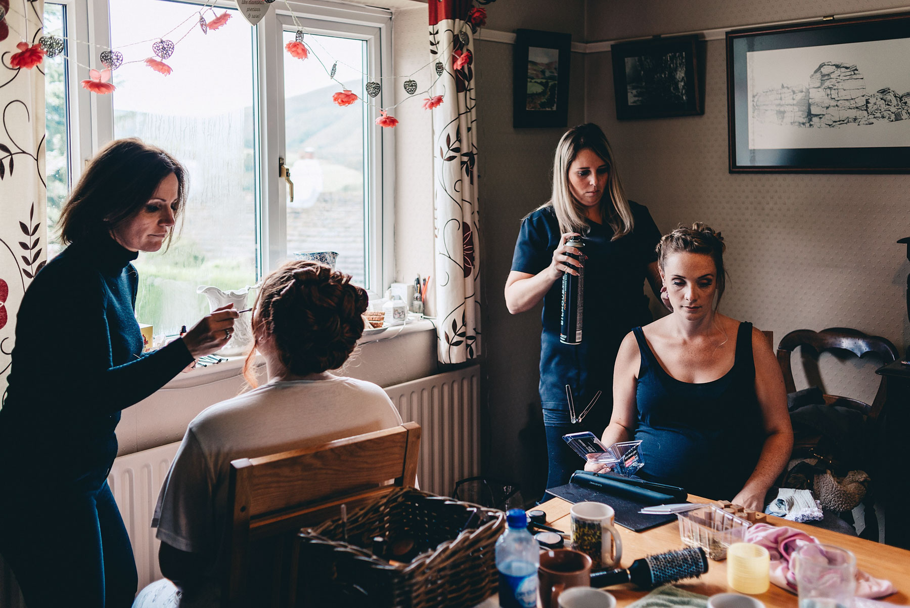 Bridesmaids getting ready in the morning