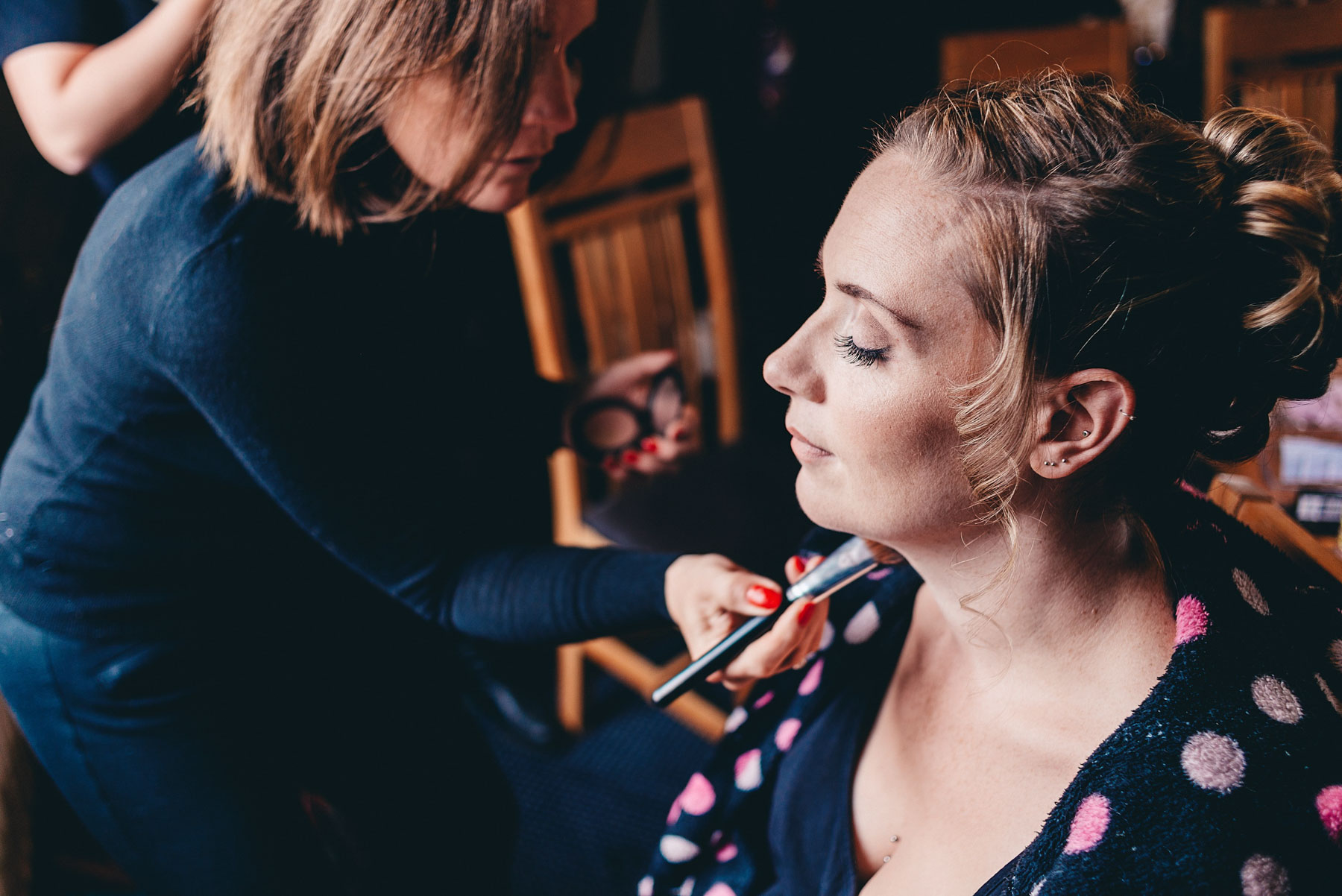 Bridesmaid getting her make up applied