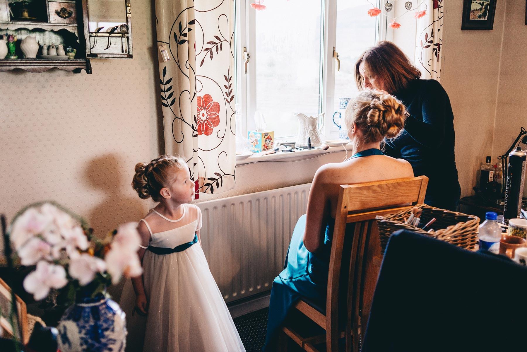 Young bridesmaid watching makeup
