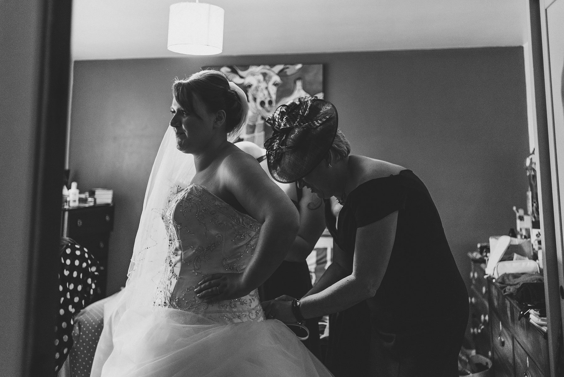 Mother of the bride helping her daughter