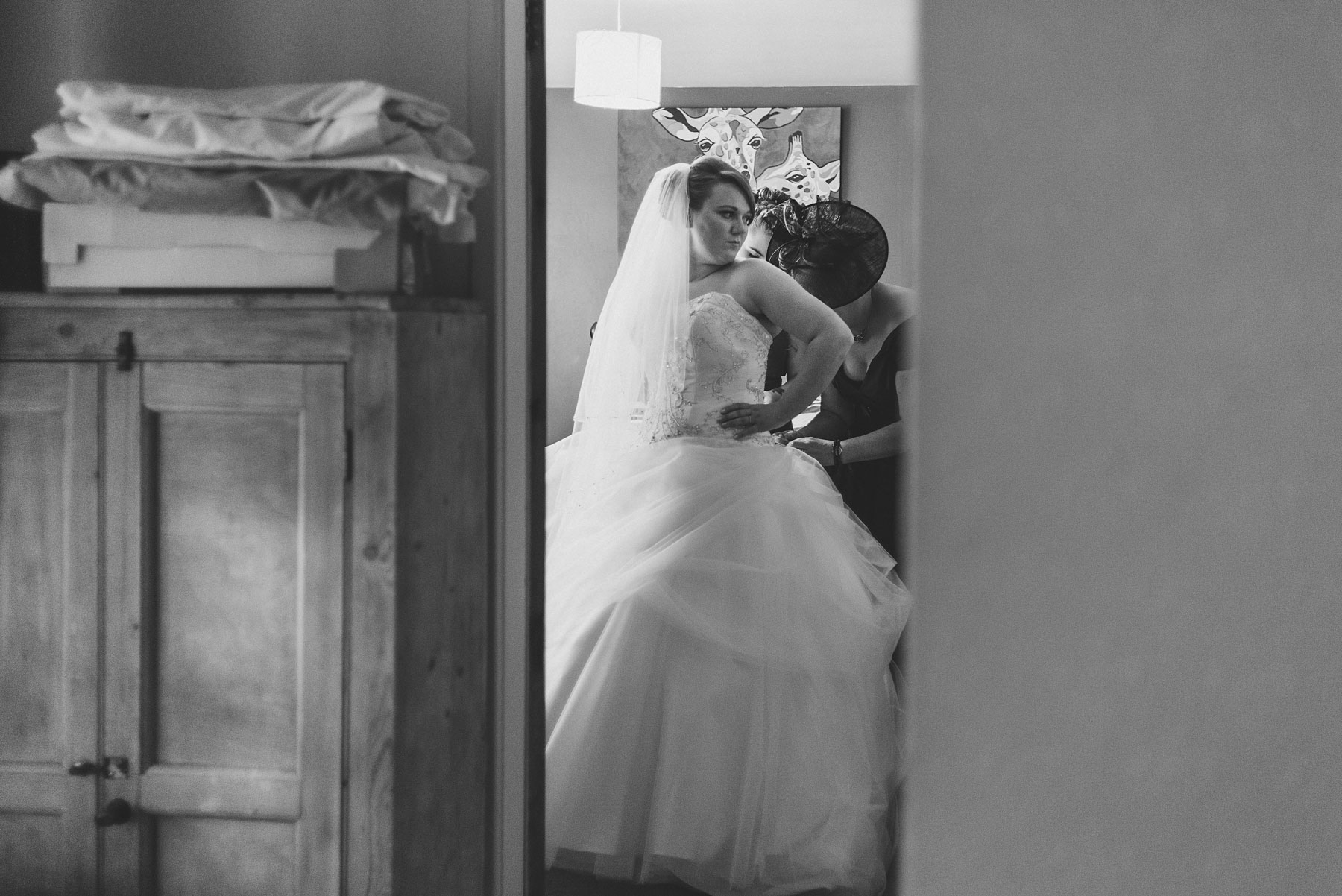 Bride getting into her dress in the morning