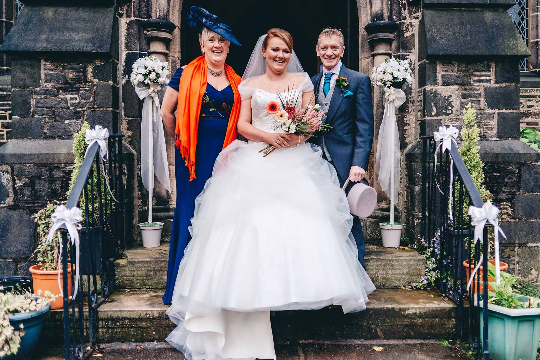 Bridal party on the steps of church