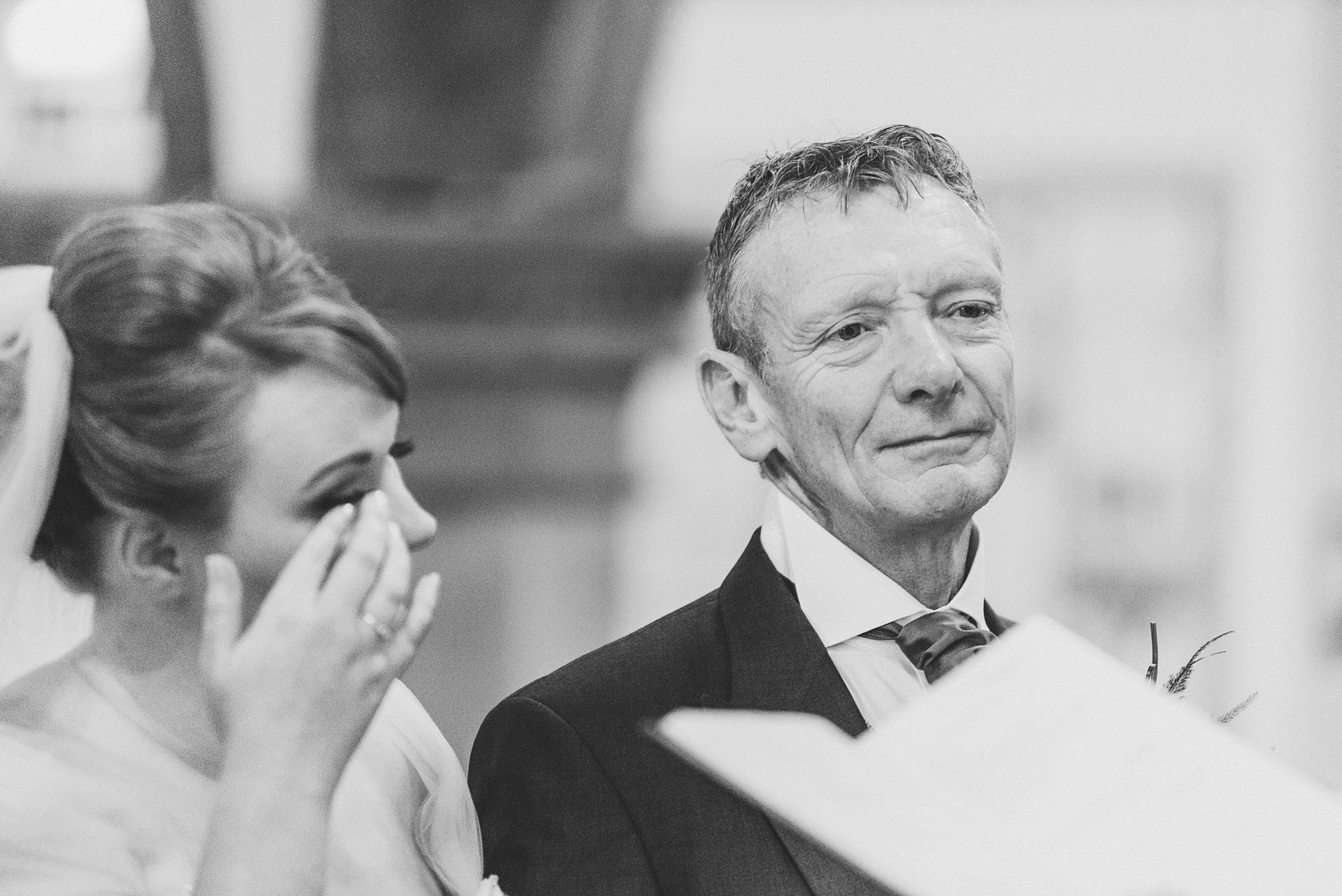 Bride gets emotional while her farther looks on proud