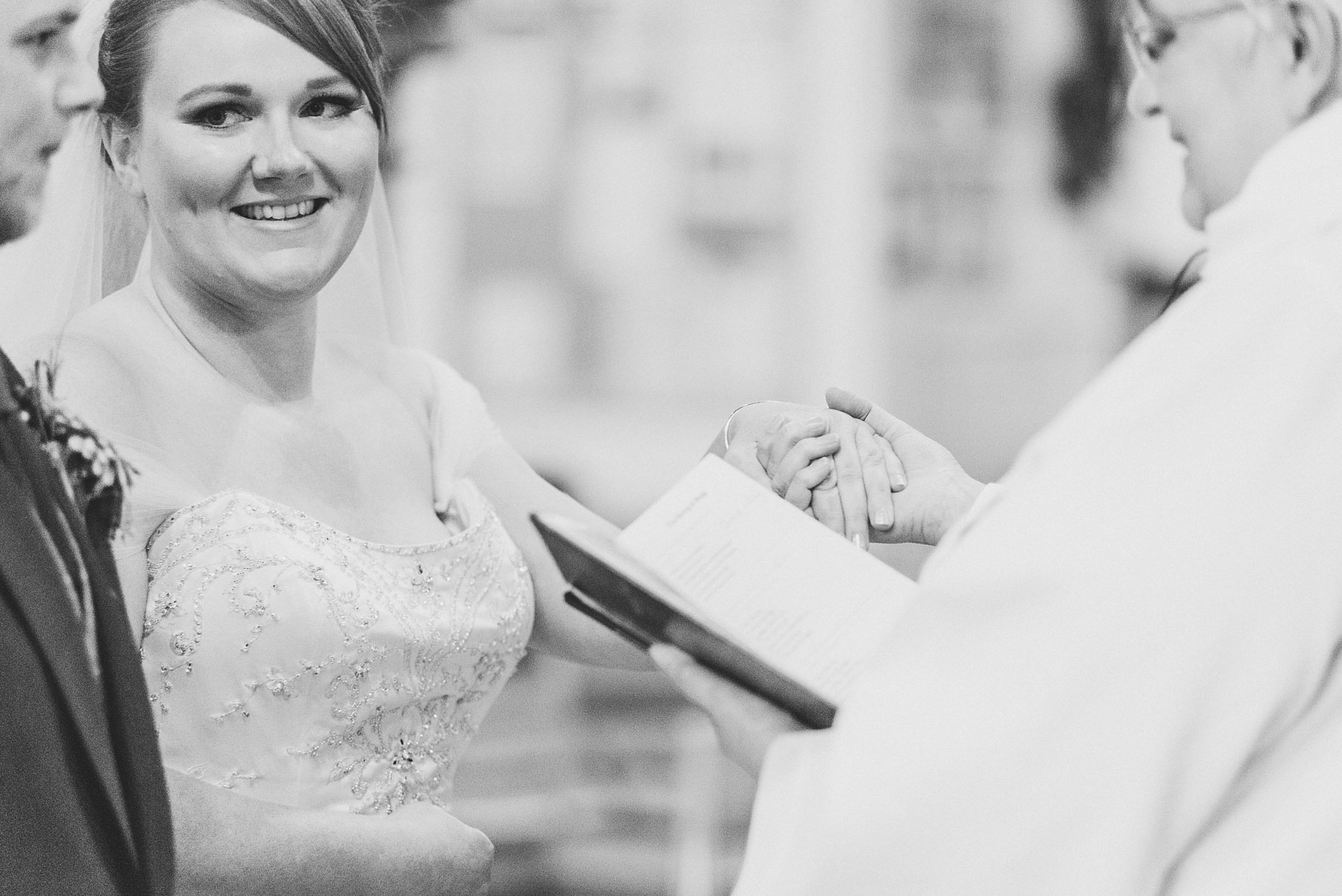 Bride looks at groom during service