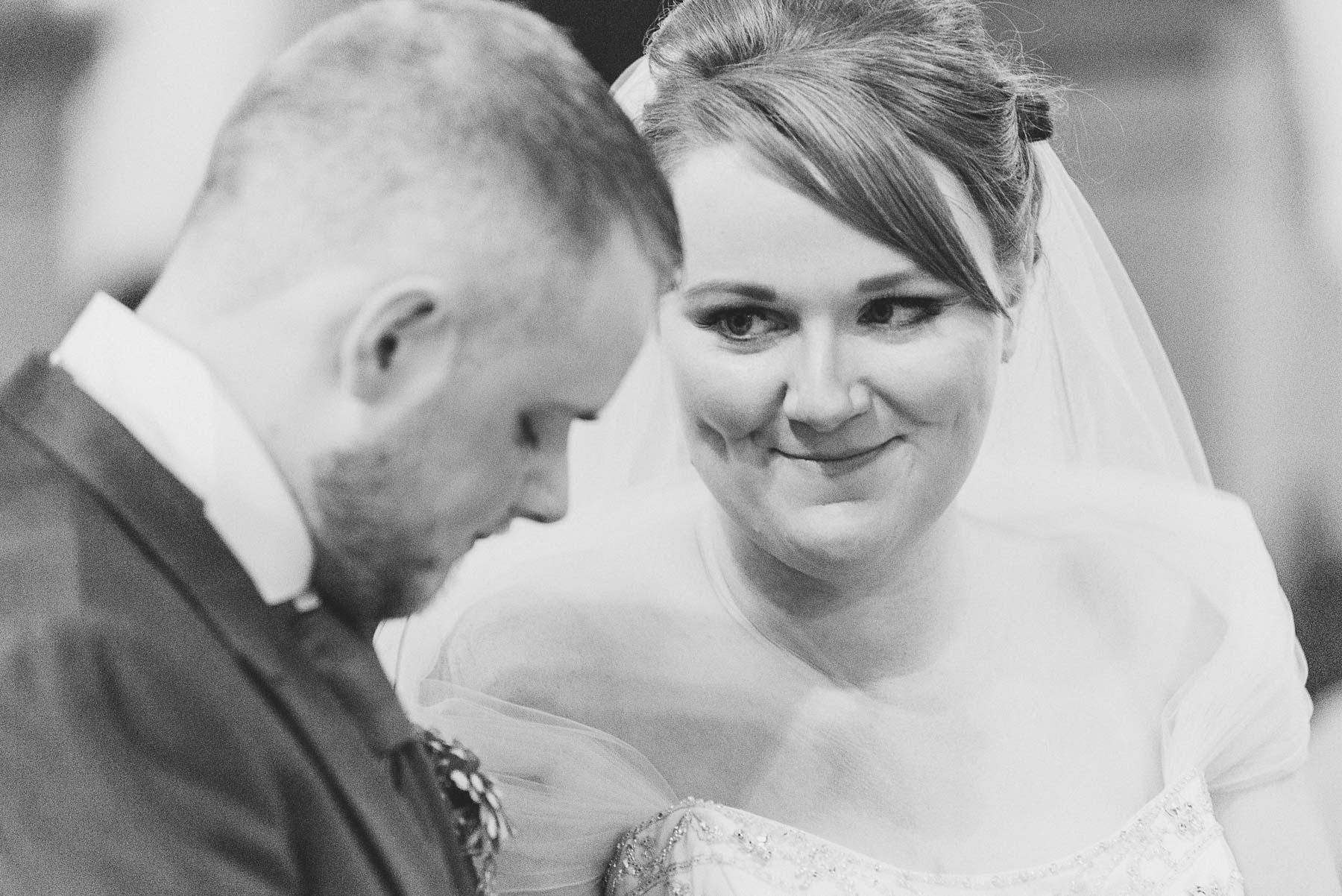 Bride looks happily at groom