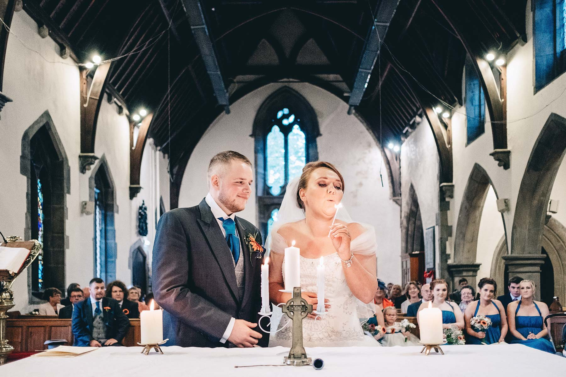 Bride blows out candle