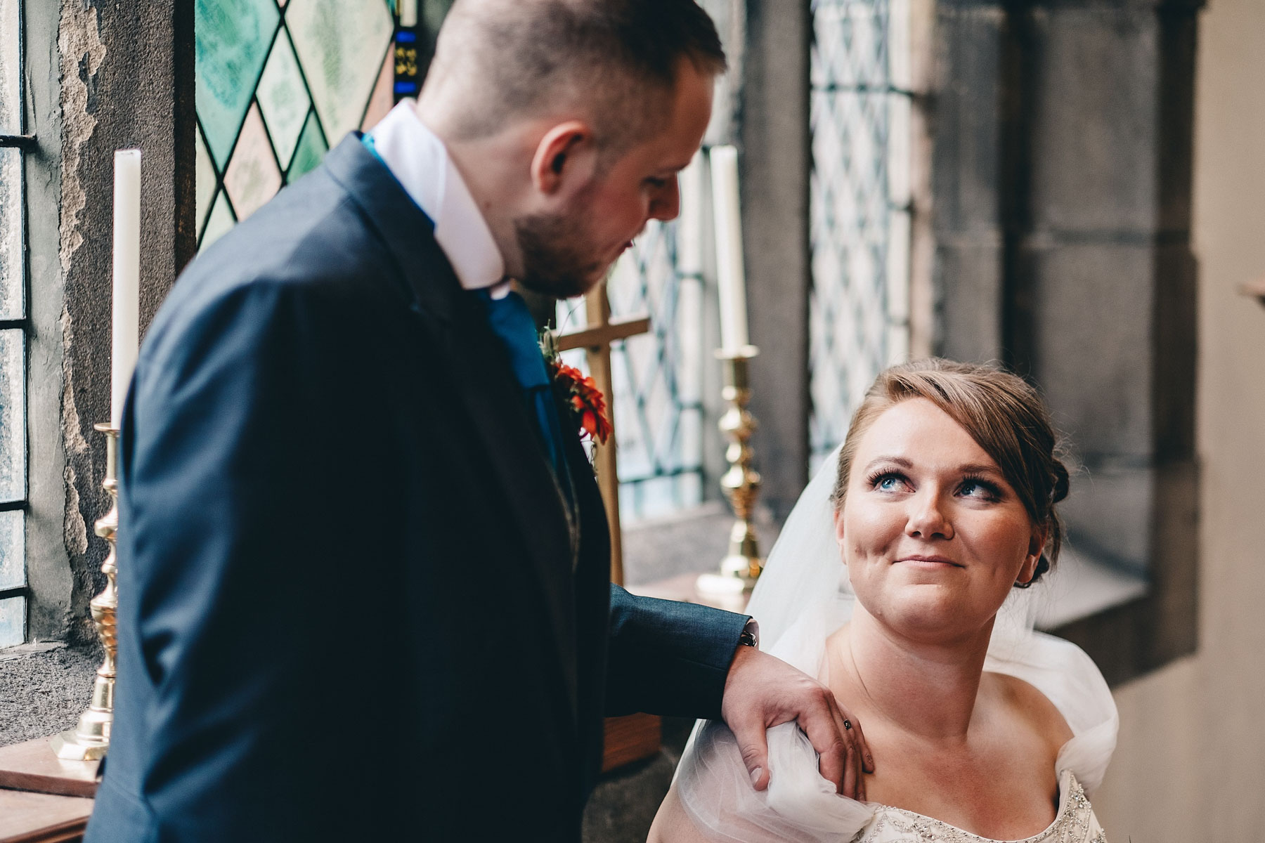 Bride and groom look lovingly at each other