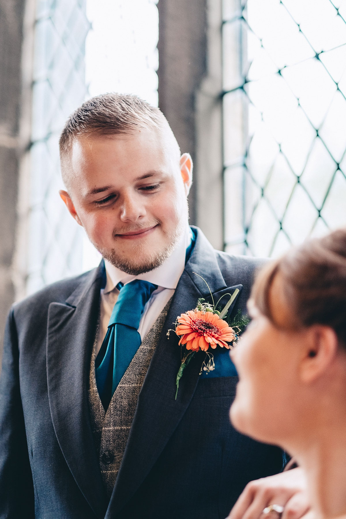 Groom looks down at his new wife