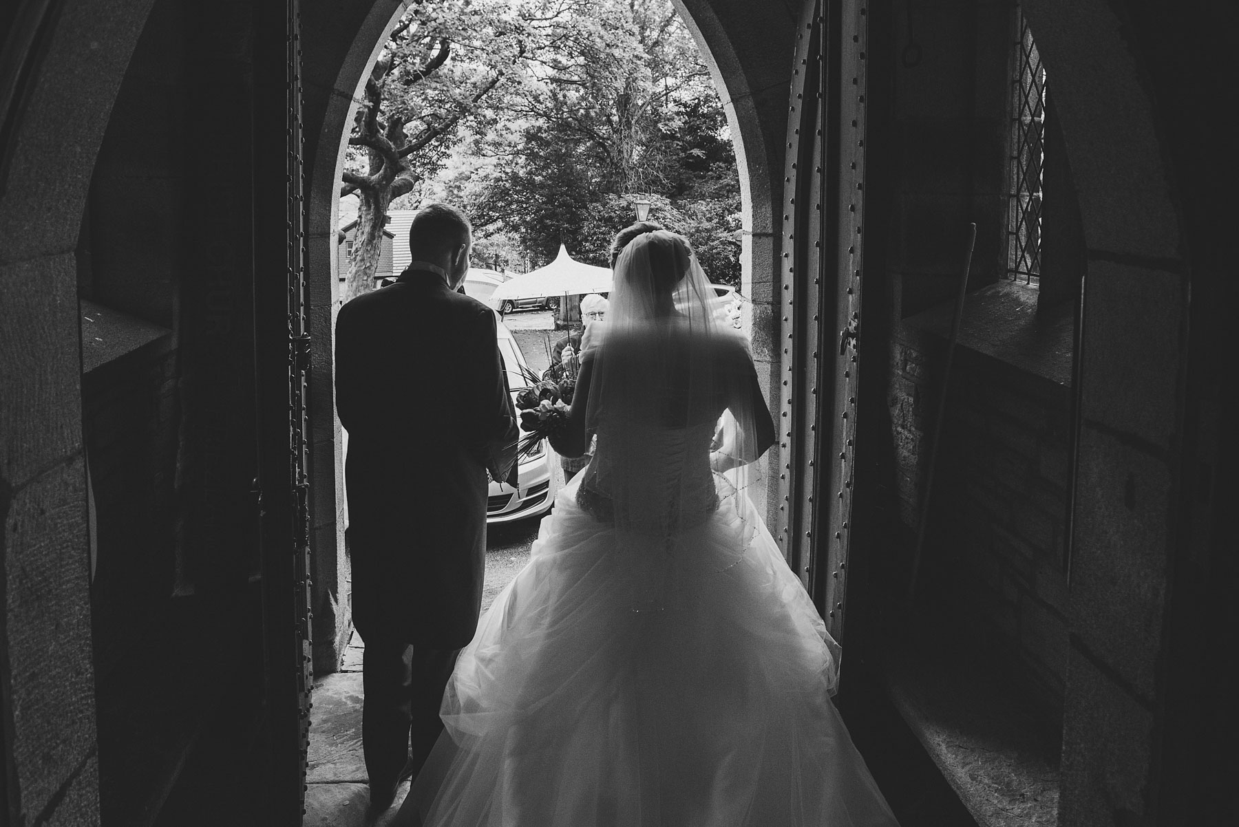 Bride and groom leave church after getting married in Saddleworth