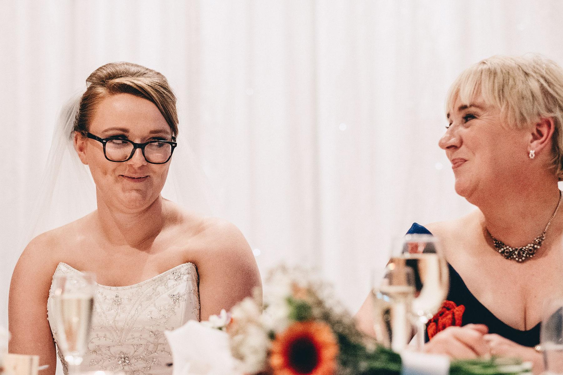 Bride looks at mum during wedding speeches