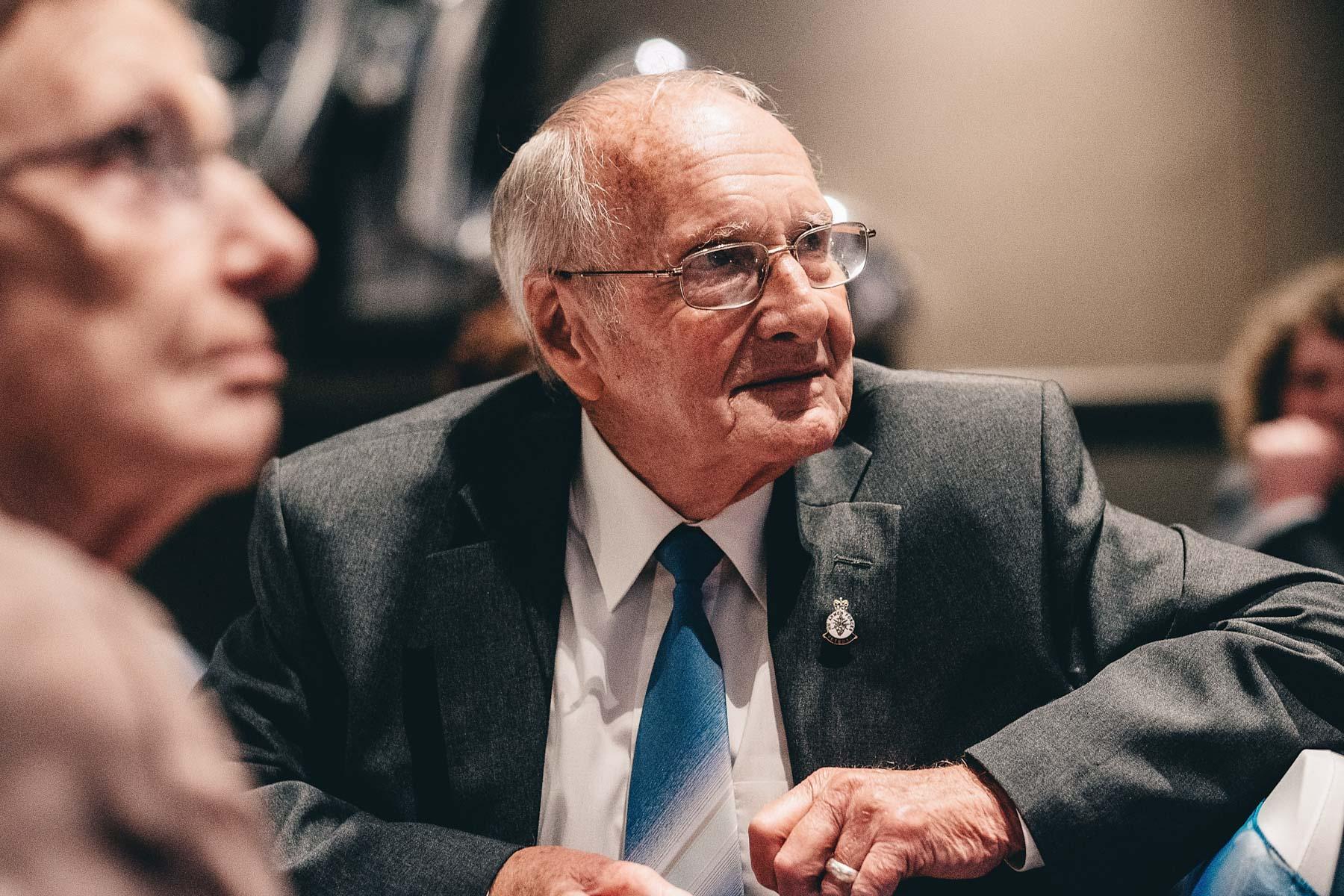 Grandad looks on with pride