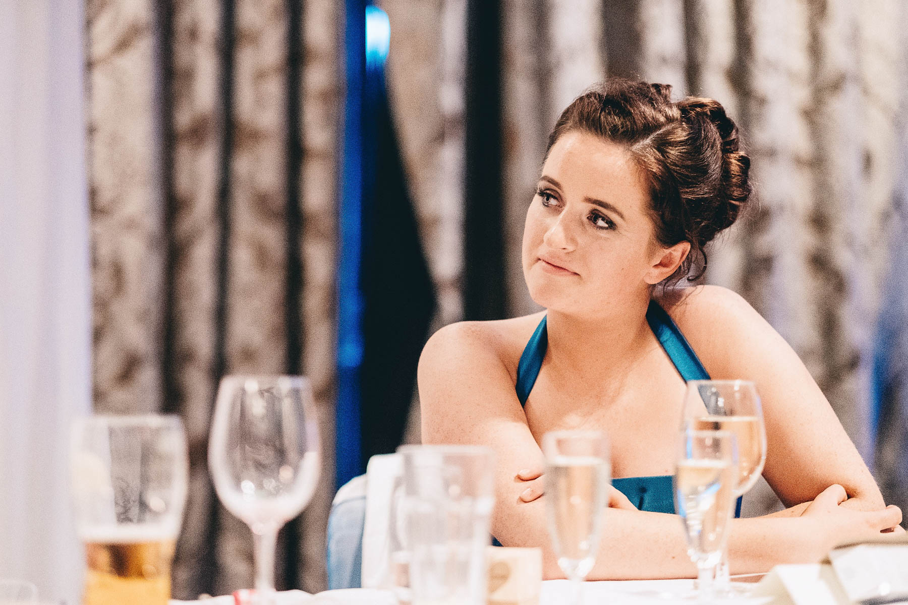 Bridesmaid looks on during speech