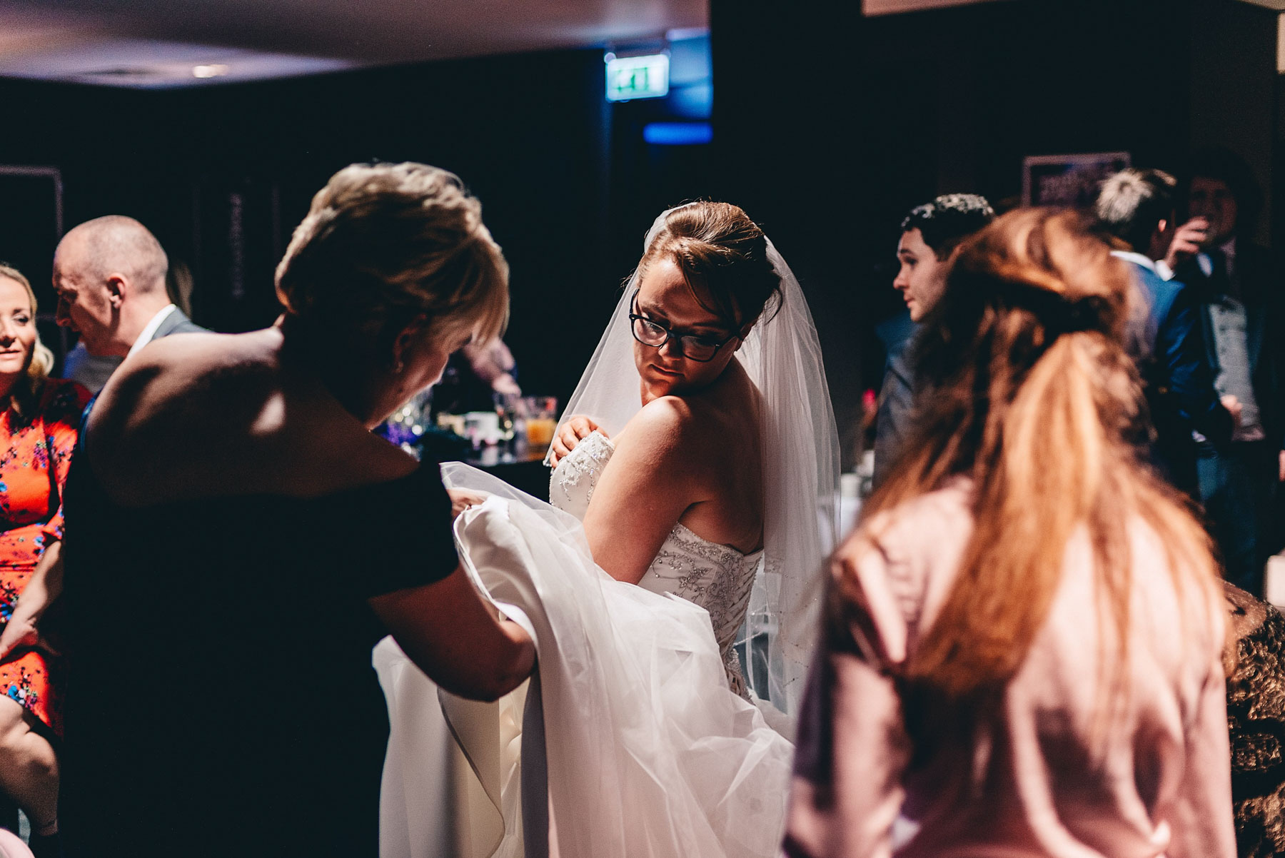 Bride looks down at her dress