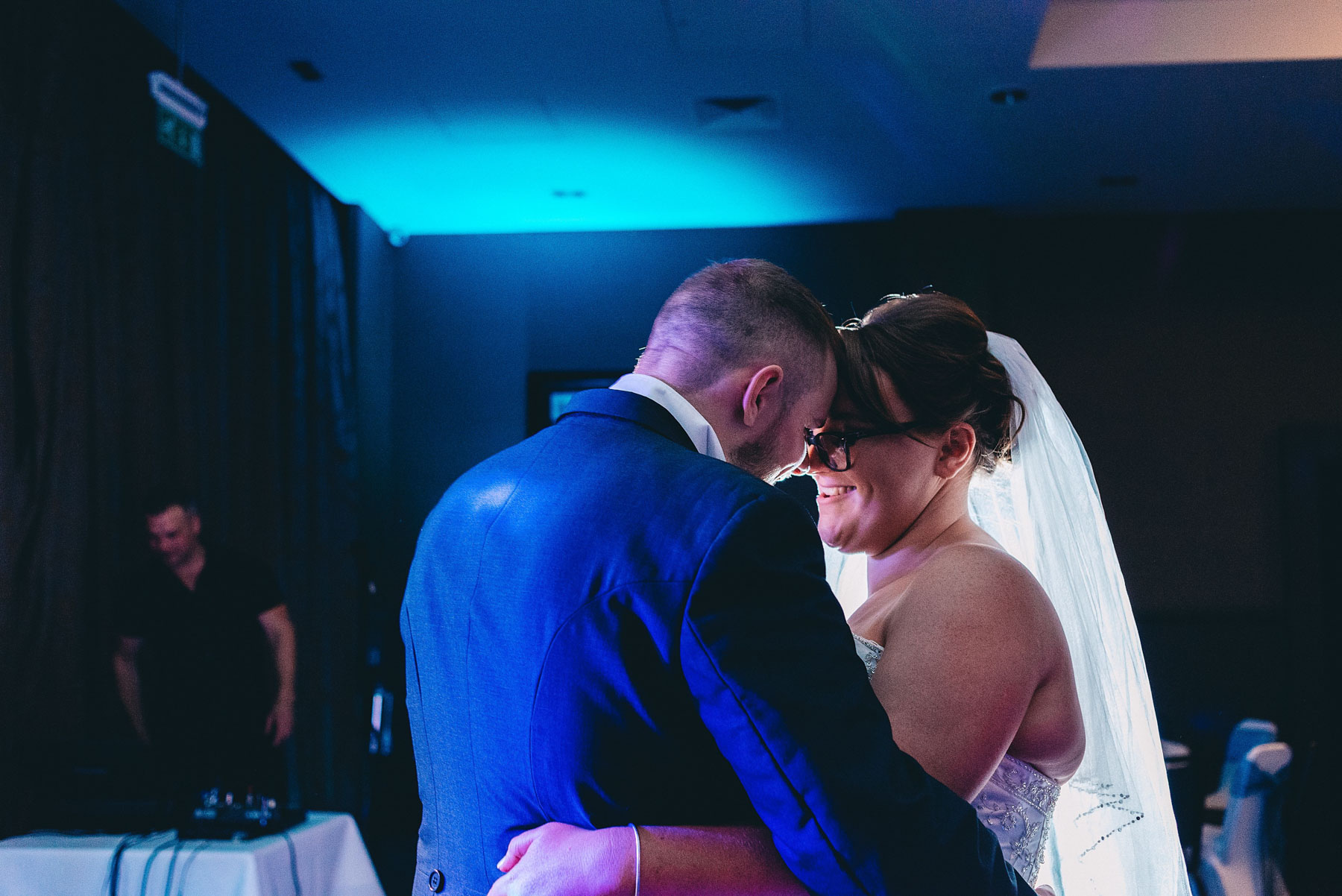 Bride and groom touch heads during first dance