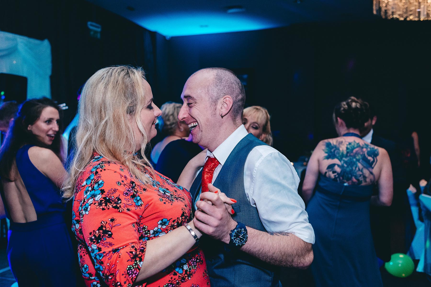 Couple enjoy dancing at wedding