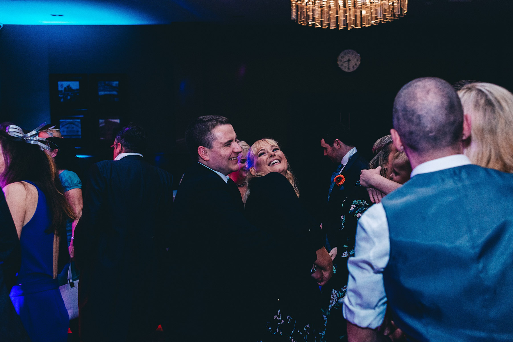 Couple dance together at wedding reception