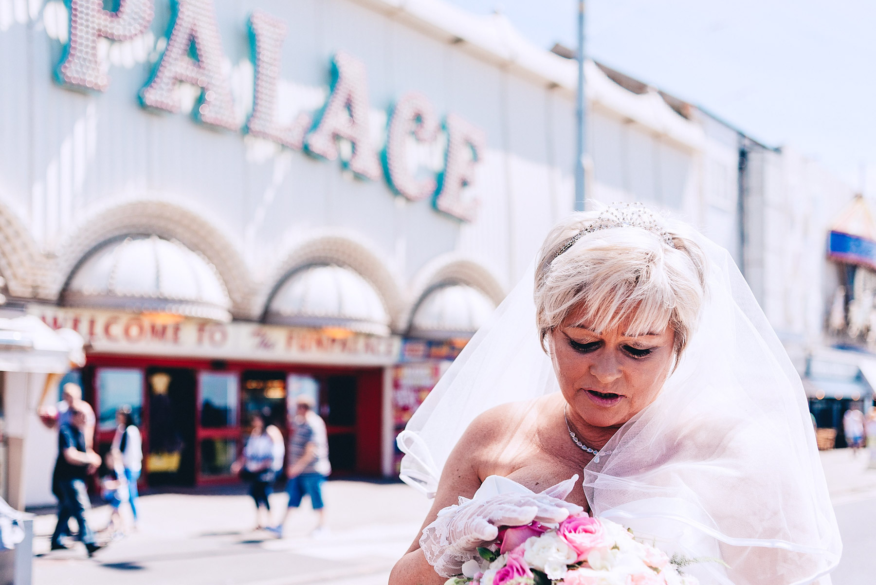 Bride looks at her flowers in Blackpool