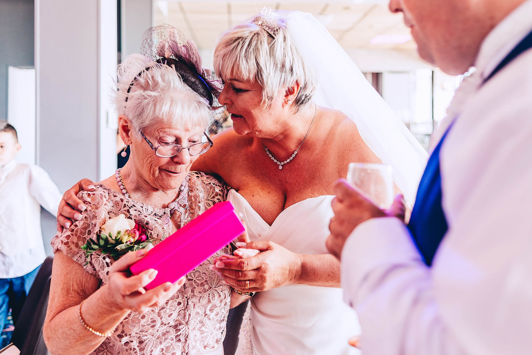 Mother of the bride is emotional after receiving present