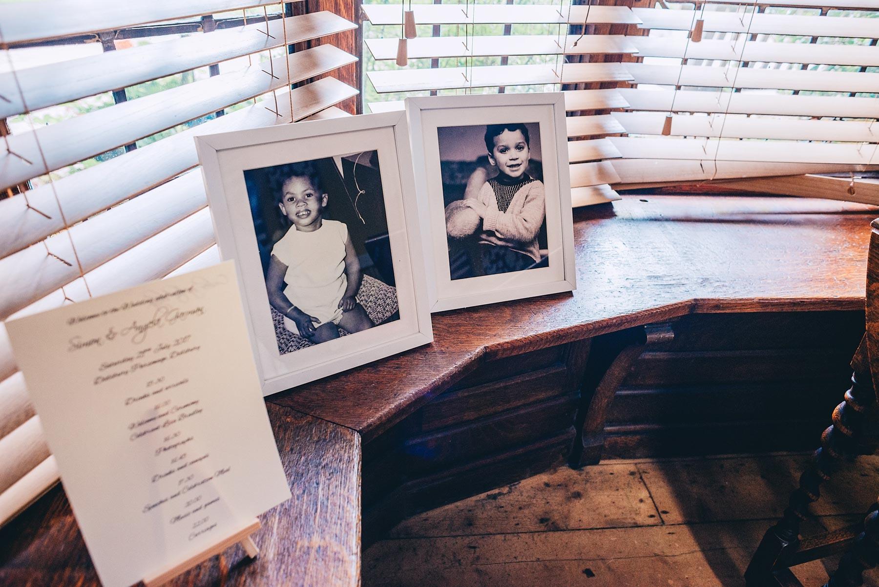 Old photos of family next to window
