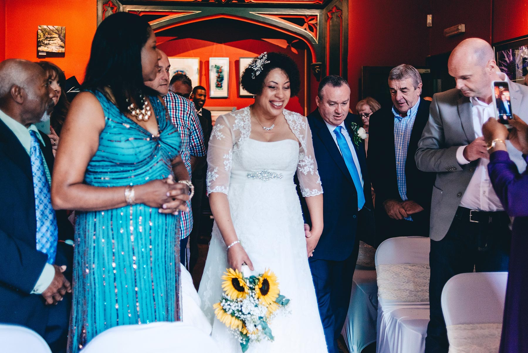 Couple walk up the aisle together