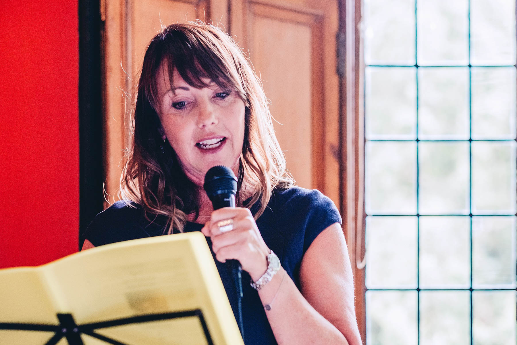 Celebrant reads for the wedding guests