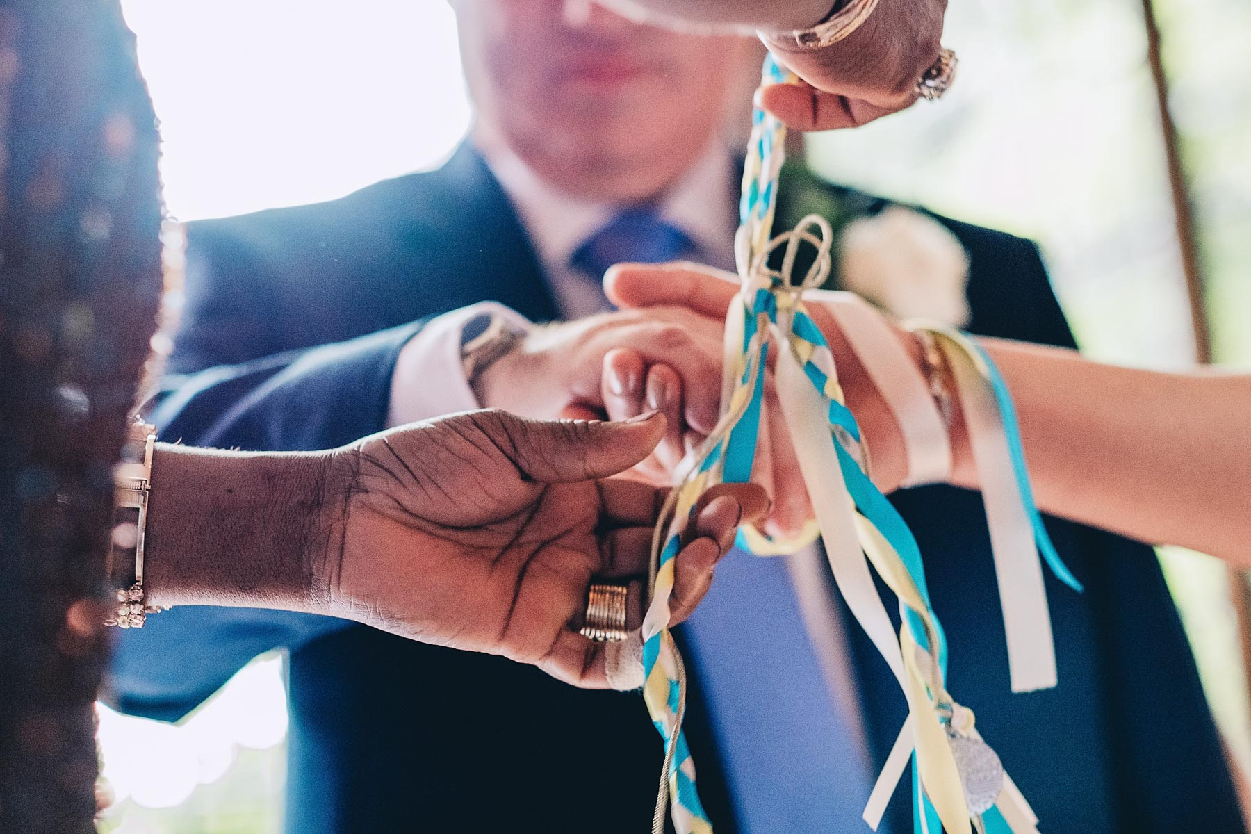 Bride and groom's hands are tied during handfasting