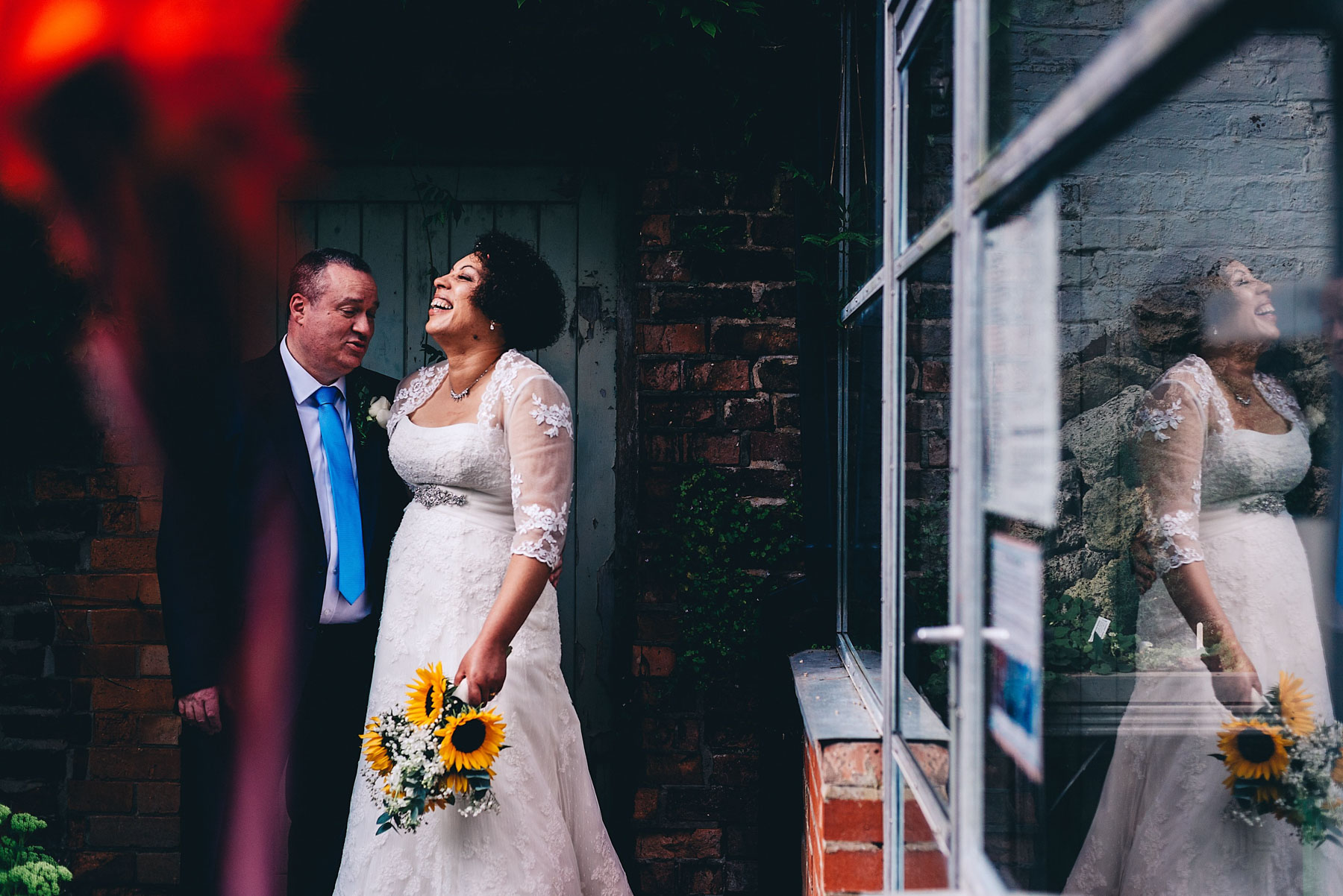 Bride laughs with Groom