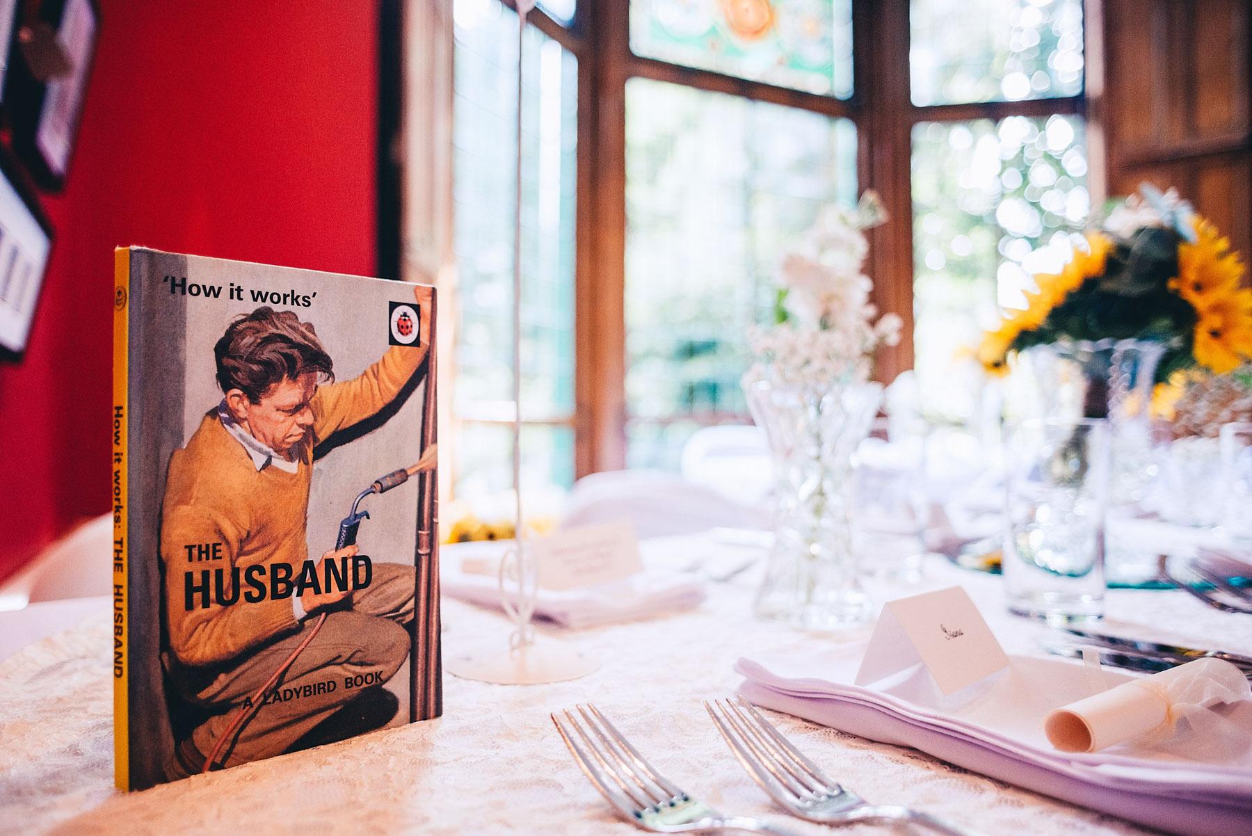 The husband ladybird book set up on wedding table