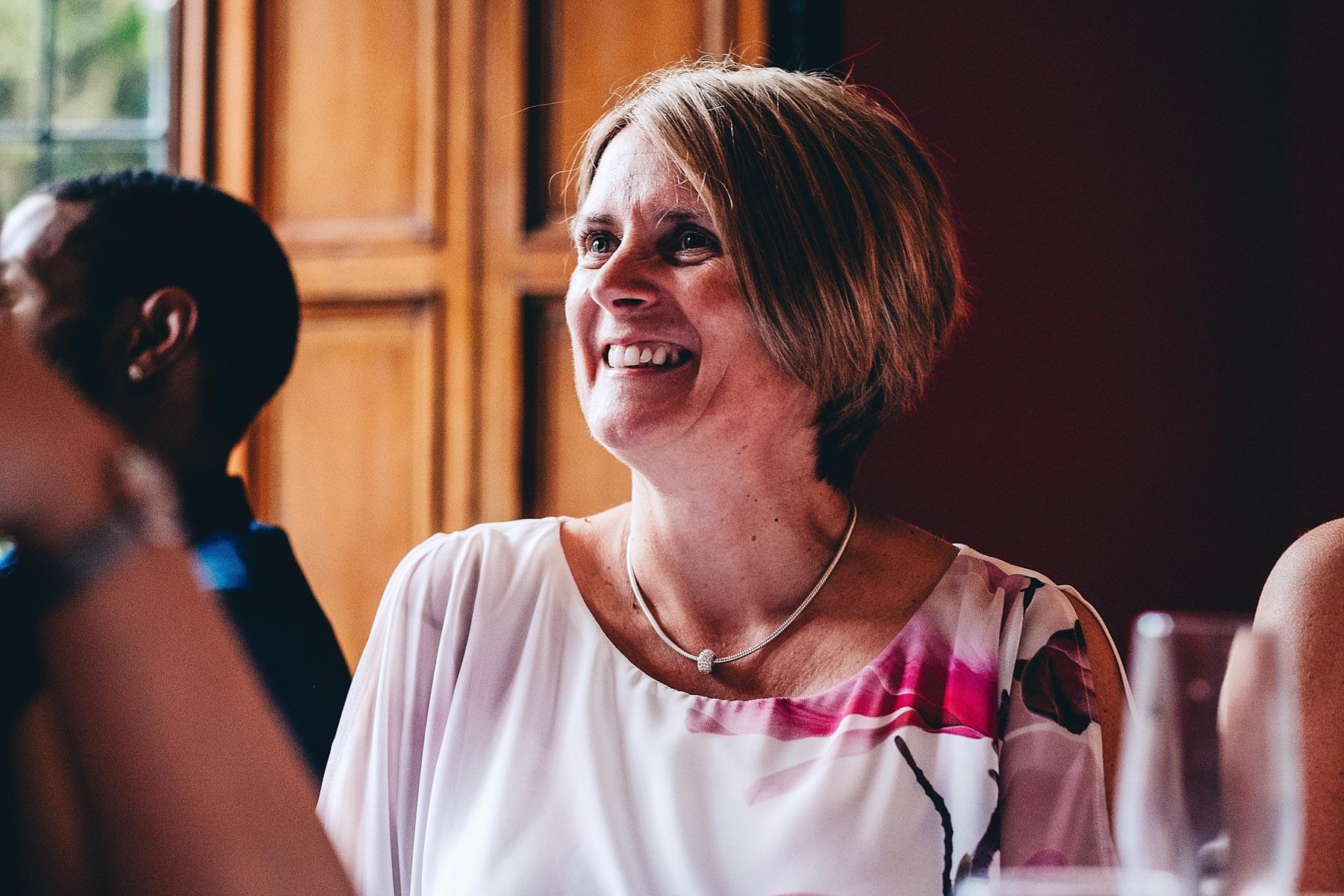 Guest laughs during wedding bestman speech